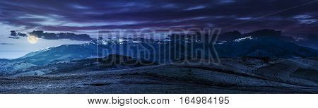 Panorama Of Rural Fields In Mountains At Night
