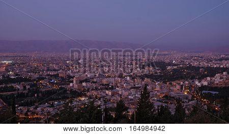 Sunrise view of the Shiraz city from the surrounding hills. Iran