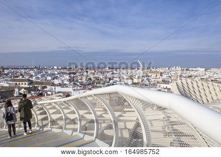 Unidentified young couple in love outdoor in Metropol Parasol Seville Spain