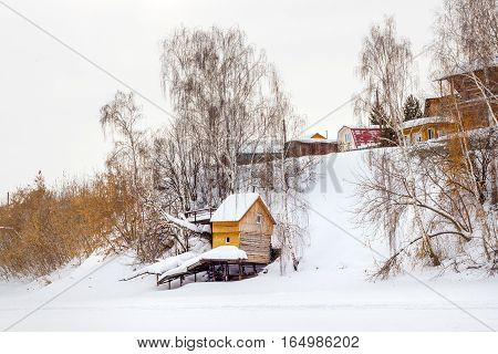 Berdsk Novosibirsk oblast Siberia Russia - January 11 2017: winter steep to the river with the buildings of a holiday village
