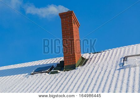 Chimney On Winter Roof