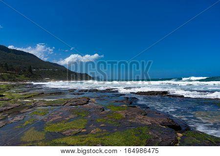 Beautiful Ocean Beach With Rocky Shore