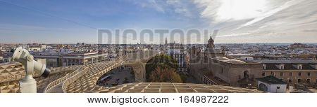 Turistic telescope over Metropol Parasol roof one of the best view of the city of Seville Spain. Panoramic shot