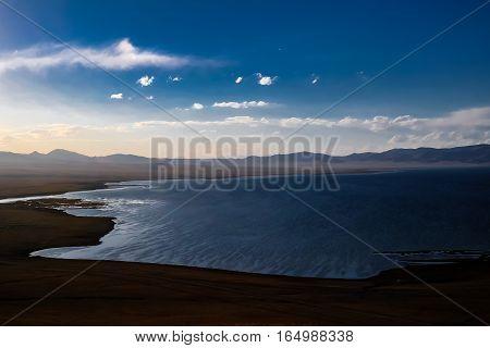 Panorama of Song Kul lake at the sunset Kyrgyzstan