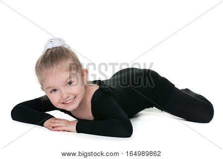 Smiling Little Girl Performs Gymnastic Exercise