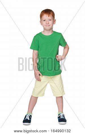 Young Smiling Boy In A Green Shirt