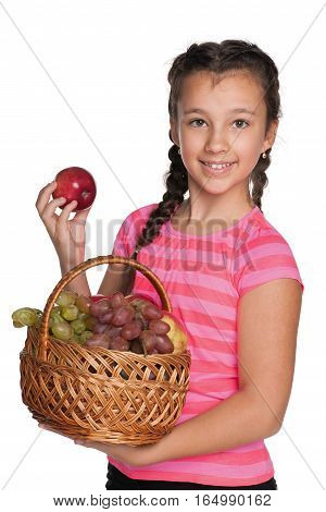 Girl Holds A Basket With Vegetables