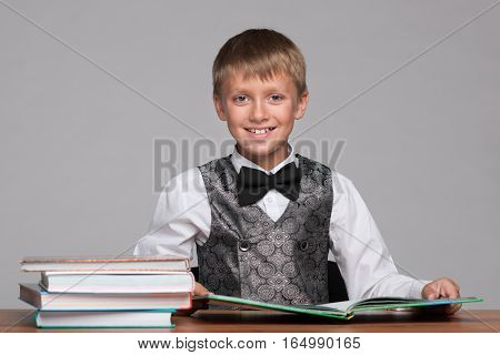 Young Boy At The Desk With Books