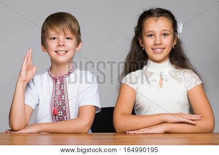 Two Children Seat At The Desk