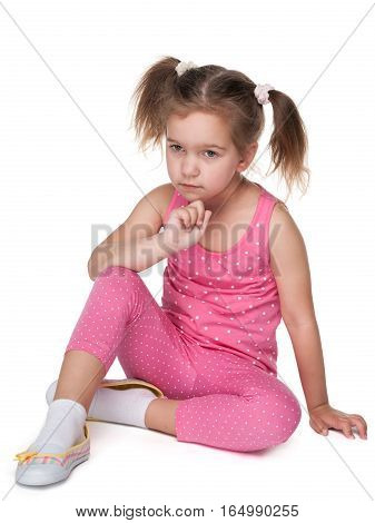 Upset Little Girl Sits On The Floor
