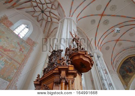 VILNIUS, LITHUANIA - JANUARY 2, 2017: The interior of the Bernardine Church with wooden statues