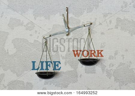 Words Life and Work and a balance on bright background