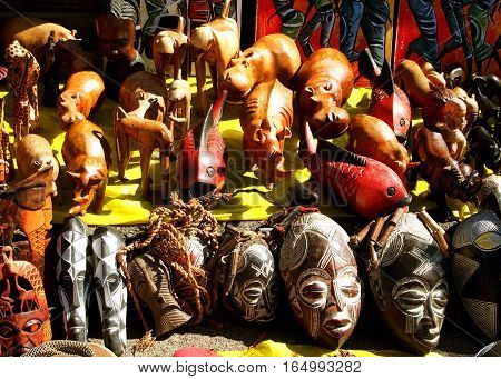 African wooden and stone souvenirs masks and wild animals on the local market. South Africa.
