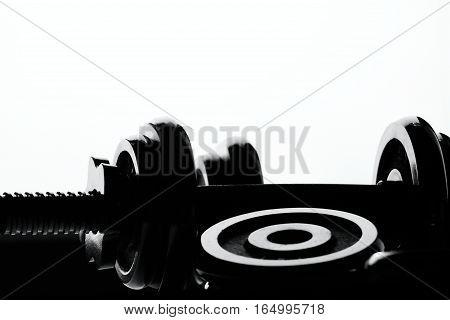 Silhouette dumbbell on  white background fot motivation.