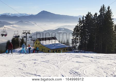 January 1 2017 . New Year. Ski park Kubinska Hola Slovakia. District Dolny Kubin near the border with Poland. Bright frosty holiday. People skiing go on chair lift. Mountain view. Theme of sports family healthy lifestyle.