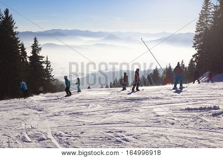 January 1 2017 . New Year. Ski park Kubinska Hola Slovakia. District Dolny Kubin near the border with Poland. Bright frosty holiday. People skiing view from the top of ski slopes. Theme of sports family healthy lifestyle.