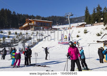 January 1 2017 . New Year. Ski park Kubinska Hola Slovakia. District Dolny Kubin near the border with Poland. Bright frosty holiday. People skiing go on chair lift. Theme of sports family healthy lifestyle.