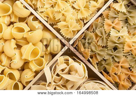 Set of italian pasta background with pipe rigate tagliatelle and farfalle