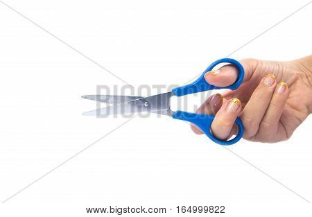 blue scissors in hand on white background