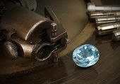 Faceting gemston big diamond with jewelery equipment. Jewellery manufacture. poster