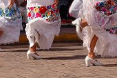 Folklore dancers performing in Merida Mexico on the zocalo. poster
