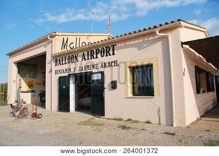 MAJORCA, SPAIN - OCTOBER 1, 2018: The headquarters of Mallorca Balloons at Cala Bona on the Spanish island of Majorca. Established in 1998, the business operates a fleet of eight hot air balloons.