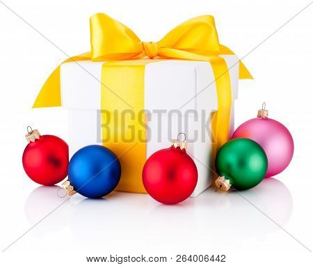 White Gift Box Tied Yellow Ribbon And Colored Christmas Baubles Isolated On White Background