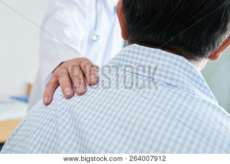Anonymous Medical Practitioner Holding Hand On Shoulder Of Unrecognizable Male Patient In Ward Of Ni