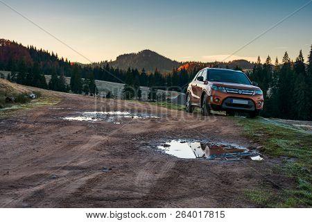 Apuseni, Romania - Oct 15, 2017: Orange Suzuki Vitara Suv Parked On The Country Road Near Forest In