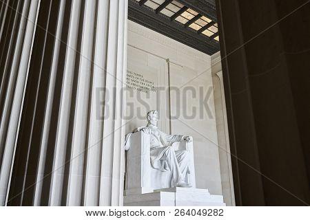 Marble Statute Of Abraham Lincoln Viewed Between Pillars. Abraham Lincoln Sitting In The Lincoln Mem