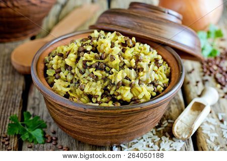 Mujadara - Lentils And Rice Pilaf With Caramelized Onion On Wooden Background, Middle Eastern Cuisin