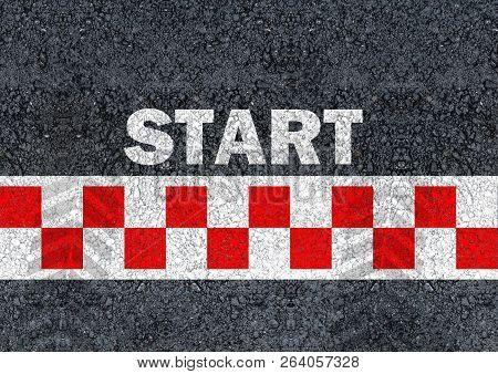 Start Written With Paint On Road Asphalt And Race Start Line
