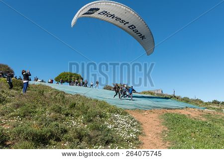 Cape Town, South Africa, August 9, 2018: A Tandem Paraglider Launch On Signal Hill In Cape Town In T