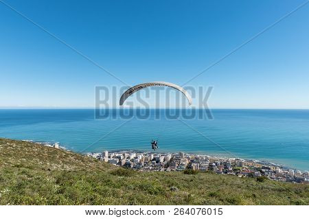 Cape Town, South Africa, August 9, 2018: A Tandem Paraglider Moments After Launch From Signal Hill I