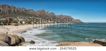 Cape Town, South Africa, August 9, 2018: Panorama Of A Beach In Camps Bay In Cape Town In The Wester
