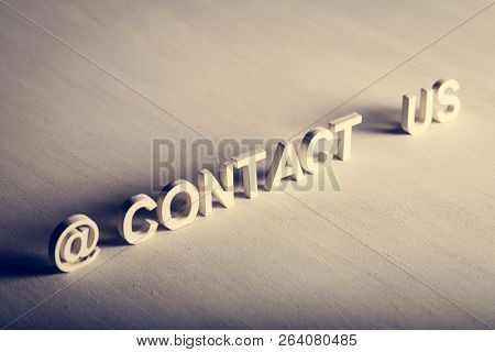 CONTACT US text made from white letters on light background. Support center, customer service, consumer help.