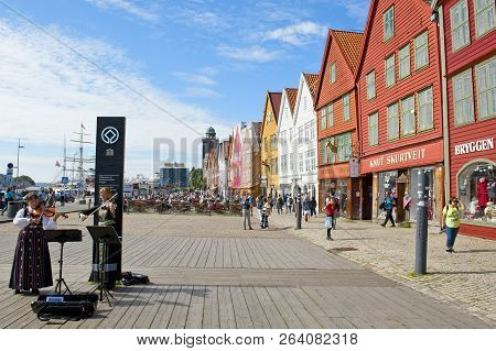 Bergen, Norway - July 15, 2018: Two Norwegian Girls In National Costumes Playing Violin At Bryggen -