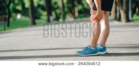 Young Fitness Woman Holding His Sports Leg Injury, Muscle Painful During Training. Asian Runner Havi