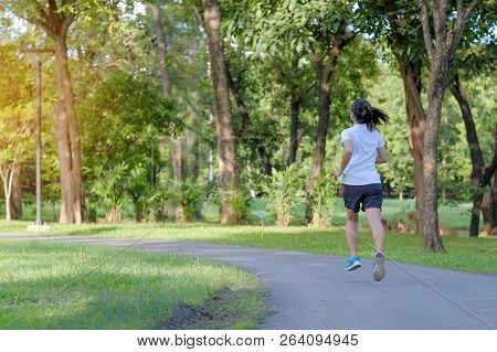 Young Fitness Woman Running In The Park Outdoor, Female Runner Walking On The Road Outside, Asian At