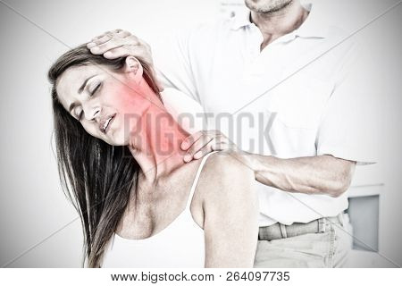 Highlighted pain against male chiropractor doing neck adjustment