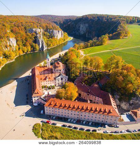 WELTENBURG / GERMANY - OCTOBER 14, 2018: Aerial view to Weltenburg Abbey - Kloster Weltenburg. This landmark is a Benedictine monastery in Weltenburg near Kelheim on the Danube in Bavaria.