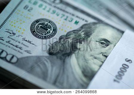10000$ stack of hundred dollar bills