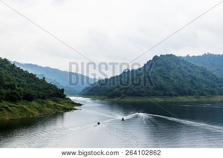 Mountains And Reservoirs Boats Take Tourists To Watch The Beautiful Scenery Of Mountains And Waterfa