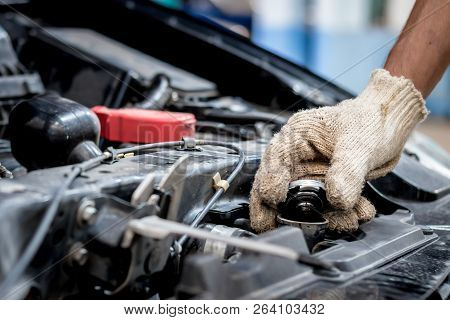Car Mechanic Are Opening The Radiator Cap. Check To See If The Water Level Reaches The Threshold Or