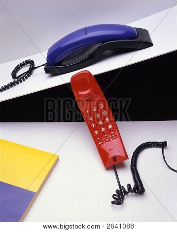 Two telephones a red and a blue