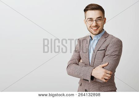 Ambitious Smart And Intelligent Good-looking European Male Entrepreneur In Glasses And Stylish Jacke