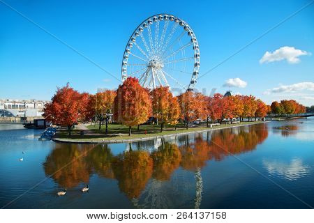 Great wheel of Montreal with his panoramic view 60 of meters high, and a breathtaking view of the river, Old Montreal and downtown city during fall season