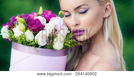Spring Woman Enjoing Flowers Gift From Lovely Man. Spring Look And Makeup At Beauty Day. Womans Day