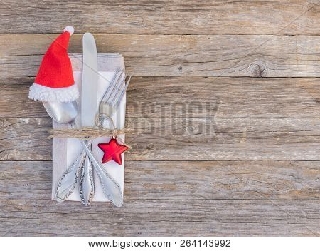 Christmas Menu Dinner Table Place Setting With Cutlery Set, Napkin And Santa Claus Cap Decoration On
