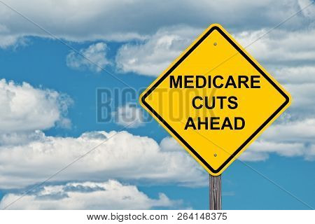 Medicare Cuts Ahead Caution Sign With Blue Sky Background